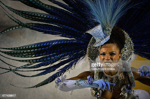 A member of the Portela samba school third in the 2014 Rio Carnival performs during the Champions' parade of the carnival's victorious samba schools...