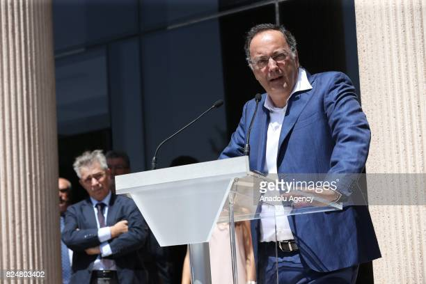 A member of the Portuguese soccer player Cristiano Ronaldo's communication agency Inaki Torres delivers a speech in front several journalists and...