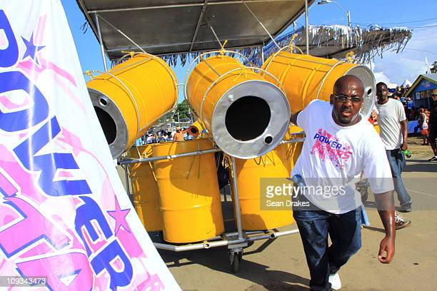 A member of the Power Stars Steel Orchestra pulls steelpans into the Queen's Park Savannah for the Panorama semifinals on Sunday February 20 2011 in...