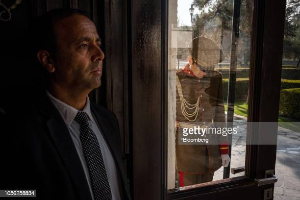 A member of the President Protective Service left stands at a door flanked by a Presidential Guard at the Presidential Palace in Kabul Afghanistan on...