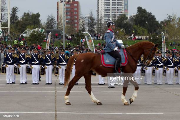 A member of the Presidential guard of mounted lancers of the Armored Cavalry Regiment No 1 quotGranaderosquot passes in front of the armed forces war...