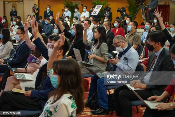 Member of the press located at the Media Center raise their hands to ask questions to Chinese Premier Li Keqiang in The Great Hall Of The People...