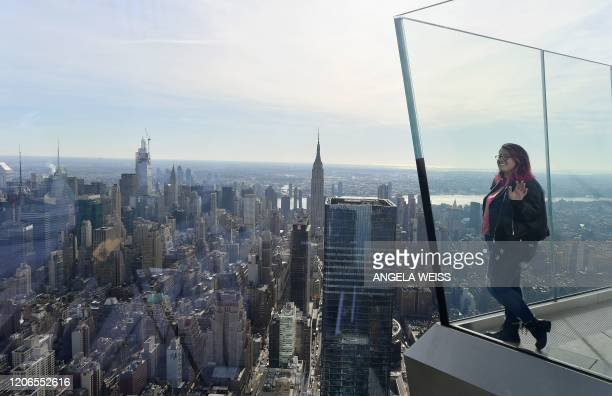 A member of the press looks at the view at the opening of Edge the Western Hemisphere's highest outdoor sky deck in New York City on March 11 2020...