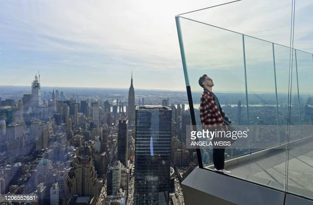 """Member of the press looks at the view at the opening of """"Edge"""", the Western Hemisphere's highest outdoor sky deck in New York City on March 11, 2020...."""