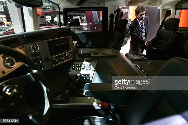 A member of the press looks through the interior of a Hummer H1 Diesel on April 12 2006 at the 2006 New York International Auto Show in New York City...