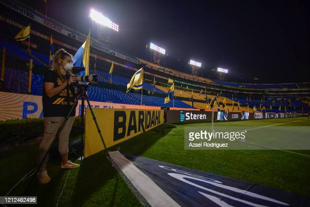 A member of the press works in an empty stadium during the 10th round match between Tigres UANL and FC Juarez as part of the Torneo Clausura 2020...