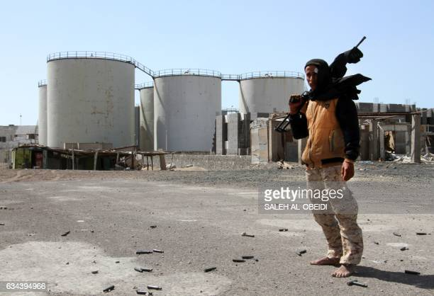 A member of the progovernment forces poses for a photo as they advance in the western Yemeni coastal town of Mokha in a bud to drive the Shiite Huthi...