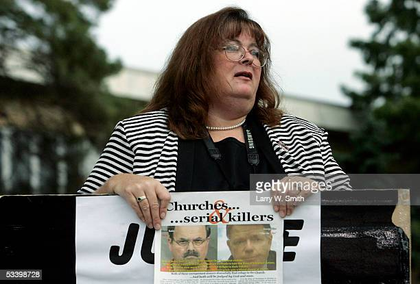 A member of the prolife group Operation Rescue who did not want to be identified by name displays a placard referring to Dr George Tiller outside the...