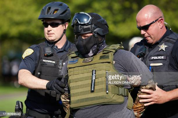 Member of the Proud Boys is arrested by Oregon police after allegedly attacking Antifa protestors in Salem, Oregon on September 7, 2020. - Pro-Trump...
