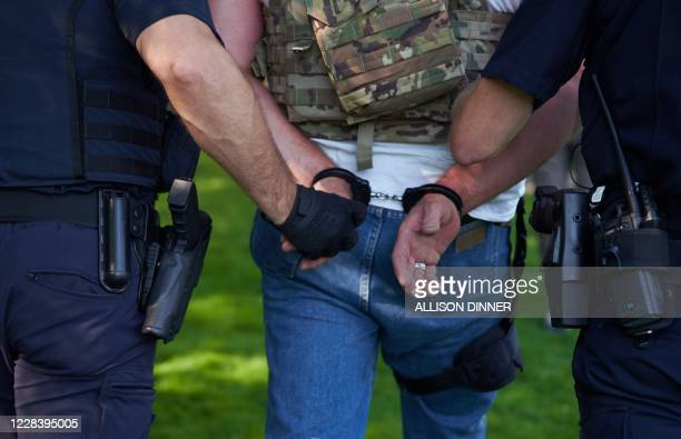 Member of the Proud Boys is seen handcuffed as he is arrested by Oregon police after allegedly attacking Antifa protestors in Salem, Oregon on...