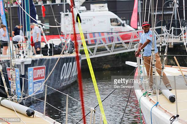 A member of the PSP Logistics crew cleans the ship in St Katherine's Dock east London on August 23 2013 The Clipper 201314 Round The World Yacht Race...