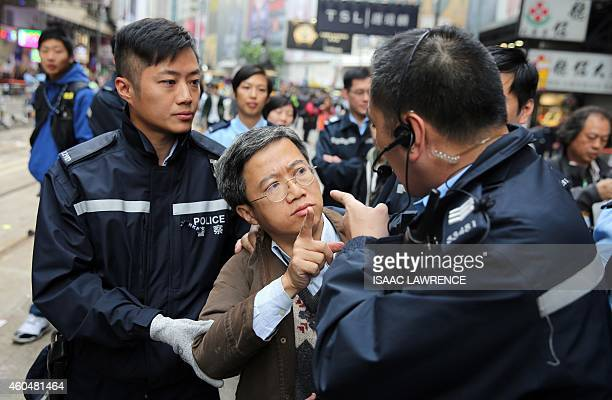 A member of the public argues with police when asked to leave the prodemocracy protest site in the Causeway Bay district of Hong Kong on December 15...
