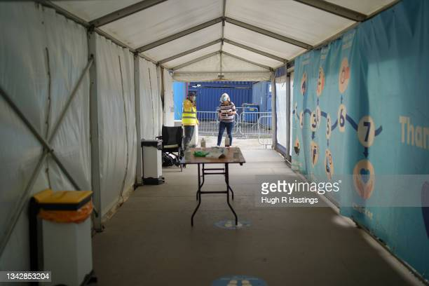 Member of the public arrives to receive their Covid vaccination at the Stithians Showground temporary NHS vaccination centre during its final hour of...