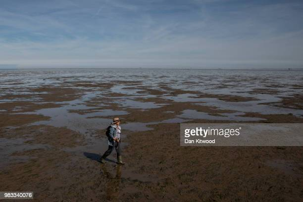 Guide Brian Dawson stops to speak to walkers as they cross 'The Broomway' during a guided walk on June 24 2018 in Shoeburyness England The Broomway...