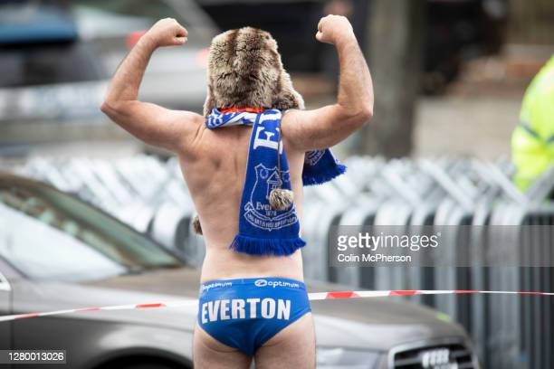 Member of the public dressed in Everton Football Club merchandise watching filming of The Batman movie which is taking place outside St. George's...