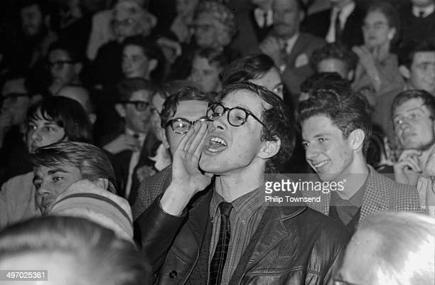 A member of the public heckling politician Quintin Hogg on stage St Pancras Town Hall London October 5th 1964