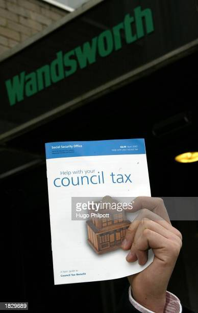 A member of the public holds a selfhelp guide for paying the council tax March 5 2003 in London England It has been announced that coucil tax bills...