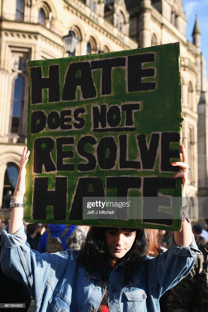 A member of the public holds a sign during a vigil, to honour the victims of Monday evening's terror attack, at Albert Square on May 23, 2017 in Manchester, England. Monday's explosion occurred at Manchester Arena as concert goers were leaving the venue after Ariana Grande had just finished performing. Greater Manchester Police are treating the explosion as a terrorist attack and have confirmed 22 fatalities and 59 injured.
