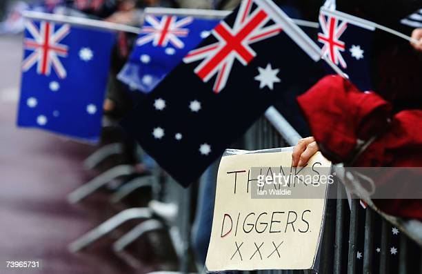 A member of the public holds a thankyou sign during the Anzac day march April 25 2007 in Sydney Australia Australians and New Zealanders today...