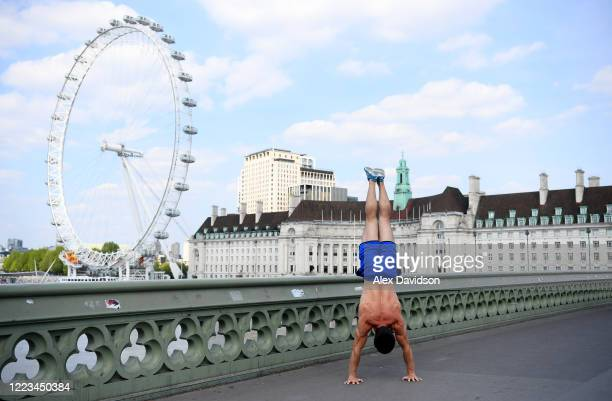 A member of the public is seen exercising on Westminster Bridge on May 07 2020 in London England The UK is continuing with quarantine measures...
