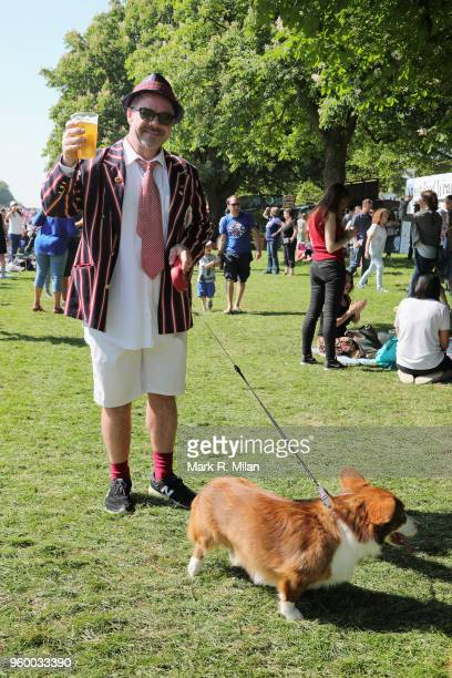 A member of the public is seen walking his corgi dog ahead of the wedding of Prince Harry to Ms Meghan Markle at Windsor Castle on May 19 2018 in...