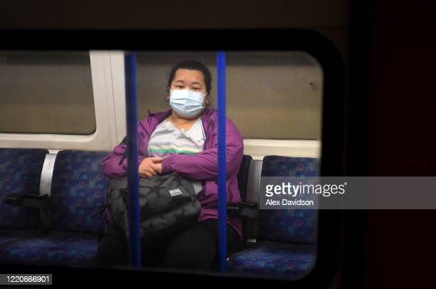 A member of the public is seen wearing a protective facemask on tube on April 23 2020 in London England The British government has extended the...