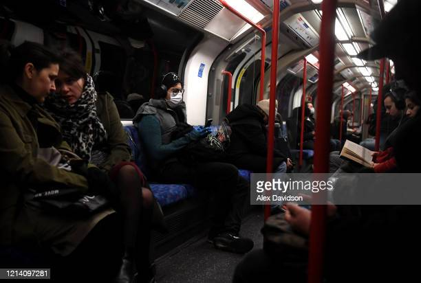 A member of the public is seen wearing a protective mask on a busy Central Line train on March 22 2020 in London England Coronavirus has spread to at...