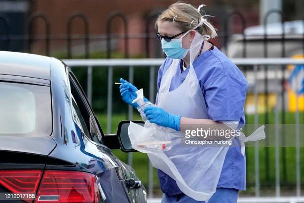 A member of the public is swabbed at a drive through Coronavirus testing site set up in a car park on March 12 2020 in Wolverhampton England The...