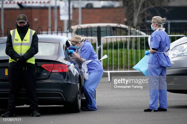Member of the public is swabbed at a drive through Coronavirus testing site set up in a car park on March 12, 2020 in Wolverhampton, England. The...