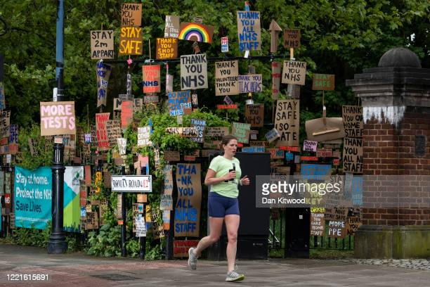 A member of the public jogs past a display of signs erected by local artist Peter Liversidge on April 28 2020 in London United Kingdom British Prime...