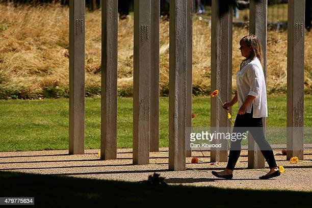 A member of the public lays a flower at the 52 steel pillar memorial to the victims of the July 7 2005 London bombings in Hyde Park on July 7 2015 in...
