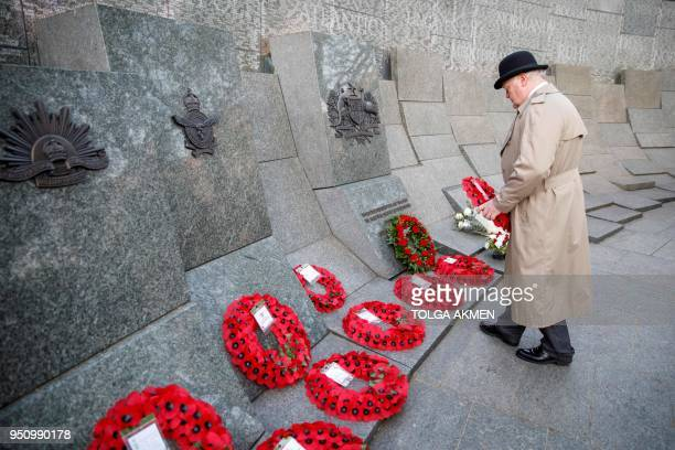 TOPSHOT A member of the public lays a wreath during an Anzac Day dawn service at Hyde Park Corner in London on April 25 2018 Anzac Day commemorates...
