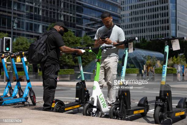 Member of the public looks at e-scooters on the day of the launch of a pilot program on June 07, 2021 in London, England. Local government have...
