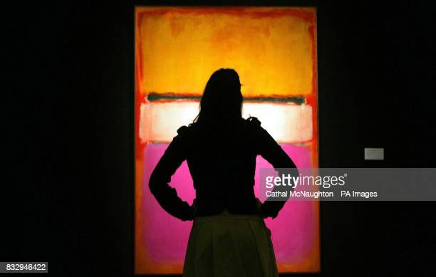 A member of the public looks at White Center by Mark Rothko from the collection of David Rockfeller at Sotheby's London which is due to fetch 25...