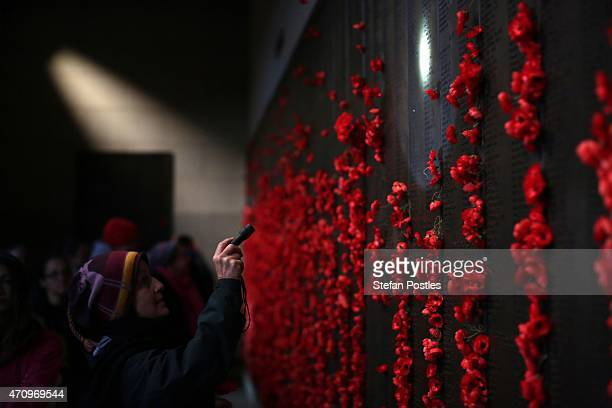 A member of the public looks for names on the Roll of Honour at the Australian War Memorial on April 25 2015 in Canberra Australia Australians are...