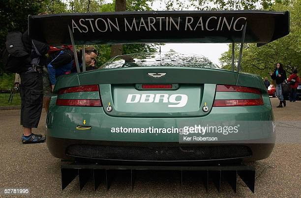 Member of the public looks inside the Aston Martin Racing DBR9 at the F.I.A. GT Championship demonstration event in The Mall near Buckingham Palace...