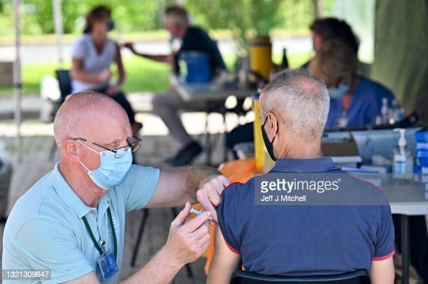 Member of the public on the South Side of the city receives their covid vaccination at a car park on June 02, 2021 in Glasgow, Scotland. Scotland's...