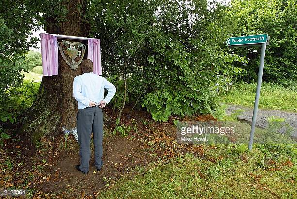 A member of the public pays his respects in front of a memorial plaque for Sarah Payne which was unveiled July 1 2003 in Pulborough England The...