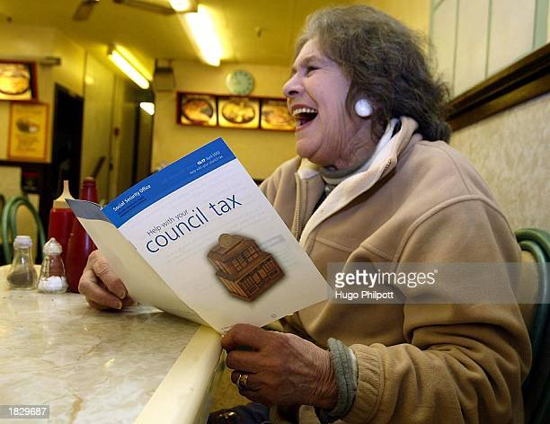 A member of the public reads a selfhelp guide for paying the council tax March 5 2003 in London England It has been announced that coucil tax bills...