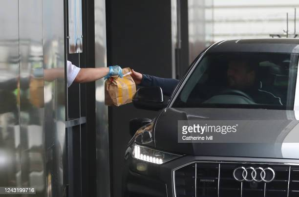 Member of the public receives his McDonald's order as the drive thru resumes trading on June 03, 2020 in Aylesbury, United Kingdom. The British...