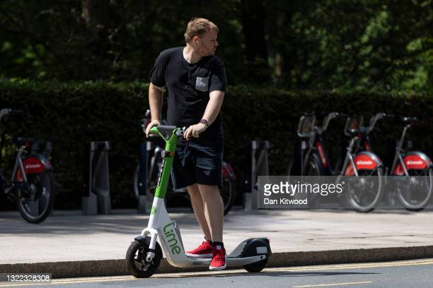 Member of the public rides an e-scooter on the day of the launch of a pilot program on June 07, 2021 in London, England. Local government have...