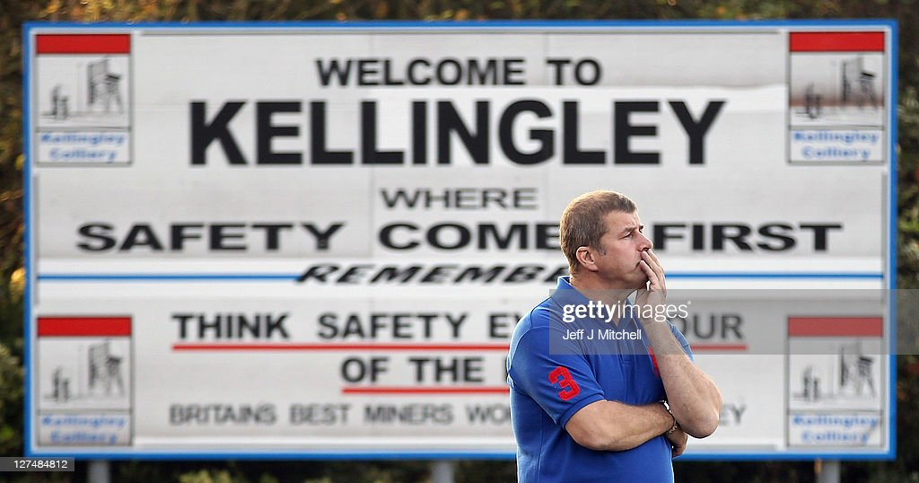 A member of the public stands outside Kellingly Colliery where last night two men became trapped in the pit following a roof fall on September 28, 2011 in Knottingley near Pontefract, England. Police and mine safety specialists have begun an investigation at the colliery where a miner died after being trapped by falling debris from a roof collapse.