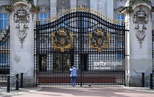 A member of the public takes a picture outside Buckingham Palace on March 21 2020 in London England Coronavirus has spread to at least 182 countries...