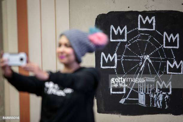A member of the public takes a selfie photograph by a new work by street artist Banksy on a wall by the Barbican Centre on September 18 2017 in...