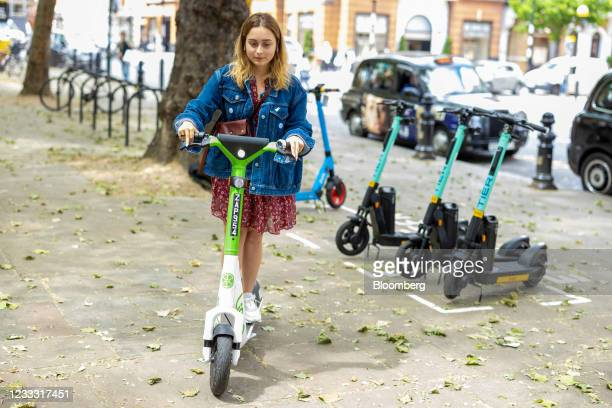 Member of the public uses an e-scooter on the first day of an e-scooter rental trial in the Kensington and Chelsea district of London, U.K., on...