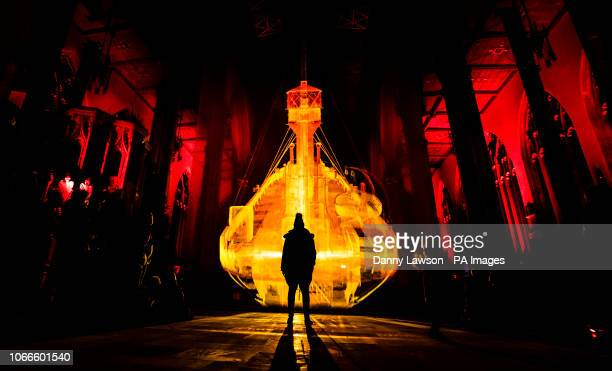 A member of the public view an art work titled Ship of the Gods in Hull Minster The work combines film 3D laser scanning technology sound and...