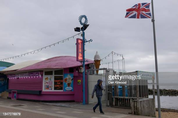 Member of the public walks along the sea front past a Union flag lowered to half mast on October 18, 2021 in Southend, England. The campaign to make...