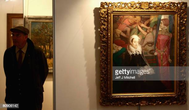 A member of the public walks past Mary Queen of Scots a painting byJohn McKirdy Duncan at a showcase of 20th century Scottish art in the Assembly...