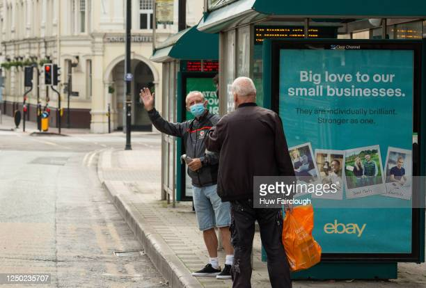 A member of the public waves at the photographer whilst waiting for a bus on June 17 2020 in Cardiff Wales United Kingdom As the British government...