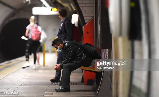 Member of the public wearing a protective mask waits for a tube at Kennington Station on May 07, 2020 in London, England . The UK is continuing with...